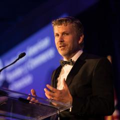 Tiny CEO Andrew Roberts accepts  the 2019 Innovation Awards at the Australian American Chamber of Commerce Australia Day Gala and Innovation Awards.