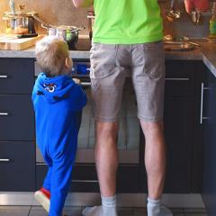 image of man and child in kitchen