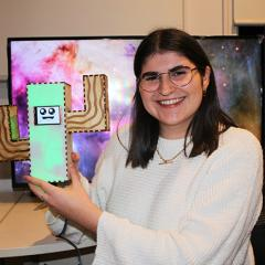 The final prototype of Lucy Davidson's interactive device 'Energy Saving Emily' will look like a cactus and will sing R.E.M's 'Everybody Hurts' if ignored.