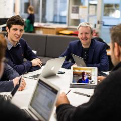 CBA project lead Michael Smith (centre) with the LendX students, including BEL and EAIT student Tara O'Kane, who Skyped in from the USA.