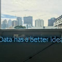 image of view outside window with text overlayed: Data has a better idea